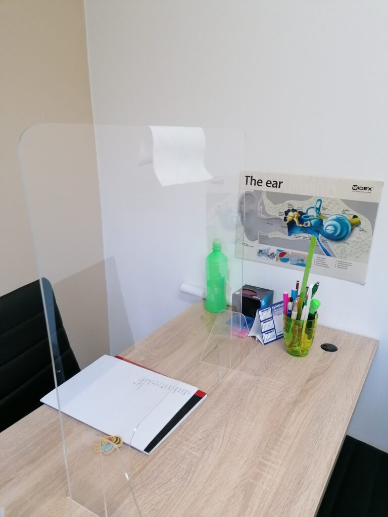 Nishara's Office desk. Notice the protective screen being used.