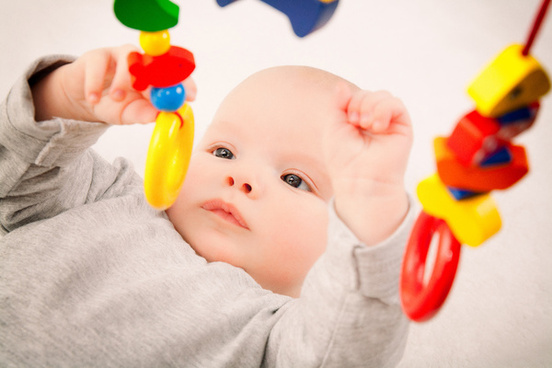 Child - early stimulation is enhanced with playing with toys.