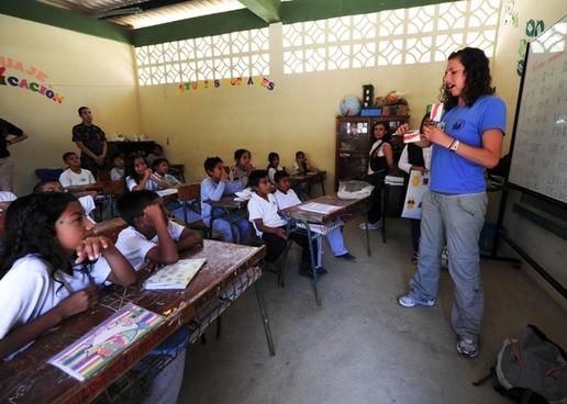 Teacher giving a lesson in a classroom.